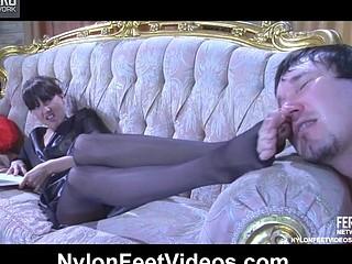 Skinny-legged angel in black sandal toe hose gives a peculiar nylon footjob