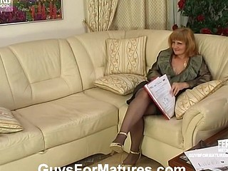 Lusty old lady-boss bares her boobs and widens legs interviewing a recent guy