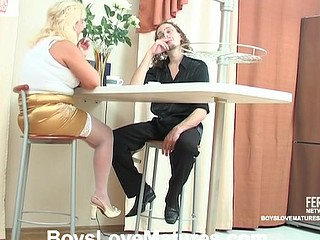 Chubby blond mamma in nylons flirting with a younger hunk desirous to get laid