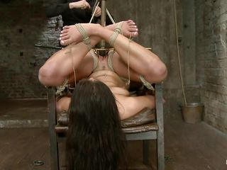 Scarlet, a 22 yo bitch is enjoying a comfortable chair and the soft touches of her mistress. Yeah right! This whore is tied up and with her ass up while mistress punishes her for being a naughty slut. She filled her pussy with a dildo and in the mean time rubbed her cunt real hard with that vibrator. Enjoy!