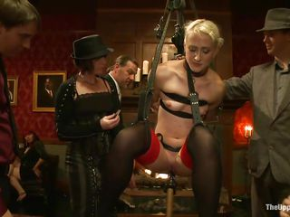 These guys are giving this girl a hard time and they are pretty thorough and meticulous about that. Odile's laying on the floor with a dildo on a stick and she's using it to fuck Dylan Ryan's hot pussy. As she gets pleasured, others put clothespins on her to mix in some pain so she's not too comfy.