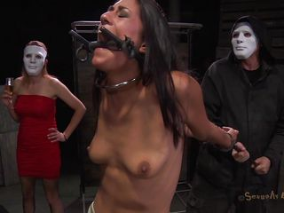 A simple yet efficient metal device keeps her neck and arms immobilized. This pretty brunette is about to have one hell of an experienced and she's scared. Masked guys put her in a cage and makes her watch how a black hunk deepthroats roughly another hot ass brunette. She got the idea that she's next