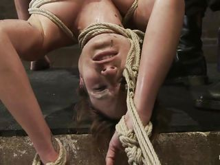 A harsh punishment is barely enough for her, she could use something even more painfully and her pretty face asks it! She's hanging there, tied with rope that goes between her pussy lips. Her executor pours hot wax inducing a lot of pain and to be sure that she's suffering metal clamps are added on her hard juicy nipples. Look at her being tormented, she deserves it and all those screams won't help her a bit as the punishment continues, are you sure you want to miss this?