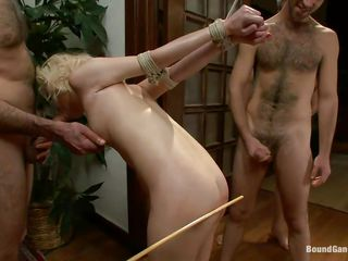 All these guys want a piece of her ass but first they spank it until it turns red and fuck her pretty mouth roughly with their big cocks. The blonde cutie is tied up and at the mercy of these horny dudes! They fuck her one by one and humiliating and dominating her. Are we going to see the blonde covered in cum too