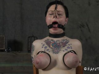 I love treating bitches the way they deserve. This one over here is my favorite and she deserves a rough treatment so I am more happy to give it to her. For starters I tie and squeeze her breasts really tight and then remove the scotch tape from her mouth. Doesn't she looks great with that dildo deep in her throat?