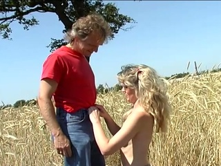 Sexy blonde queen fucked by a hard cock in the farm land