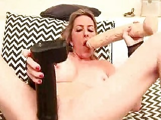 Extreme MILF fucks herself with a champagne bottle