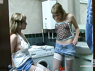 Two nasty coeds practicing lesbo love giving a kiss and fondling in a bath