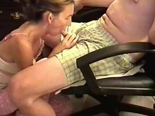 She was a bit shy because the camera was shooting, but also horny. I sat in an armchair and she knelt in front to wrap her lips around my cock. Then, she performed one of the best blowjobs ever.