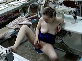 If this seamstress knew there was a cam watching her she'd never take the liberty of having a masturbation session on-the-spot! But she was unaware of the spy and eagerly rubbed her tits and packed her pussy!