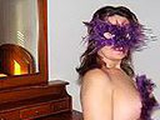 Chubby Spanish mature woman in cute bra with multicolor heart shaped patterns blows cock wearing a bizarre violet feather mask and listening to Santana's rendition of 'Black Magic Woman'.