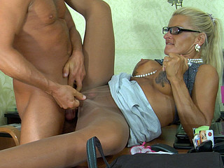 Dumb blond sec in sleek shiny hose servicing her boss in the office