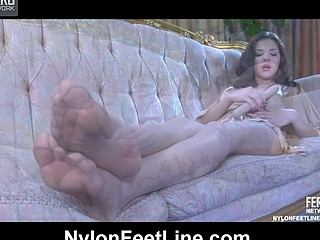 Heated hottie exposes her mile-lengthy legs and gives a footjob to a rubber penis
