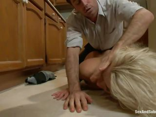 This blonde blue eyed girl gets punished, to give blowjob in her own kitchen and then gets her pussy fingered deep. She is then fucked hard and gets all her holes filled with his big dick in the lobby. After this he swanks her tight ass hard on the red carpet.