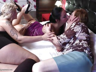 Look at this two sexy mature ladies Raisha k and Lucinda how they are having fun with a young milf fabrizia. This bitches are going crazier than ever. They are kissing each other and in the mean while they crushing the big boobs of the tattooed bitch right after they undress her.