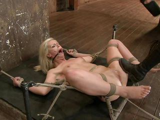 Hot babe Tara is being punished by this skilled mistress. She will have the sex experience of her life so this will be fun to watch! After the mistress tied her on that wooden beam she how laid her on her back and inserted a butt plug in her anus. Tara stays there with her thighs spread and awaits some more!