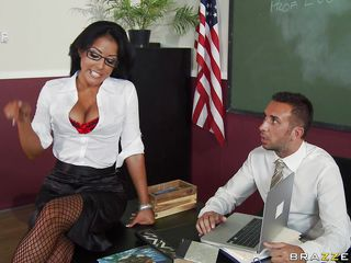 Kiara Lee is having Keiran grade papers for her. He's not concentrating well enough though, not with those big tits getting him tense and distracted. She orders him over to her to play with them, and he obeys, squeezing, kissing, and licking those huge jugs, and playing with her pussy.