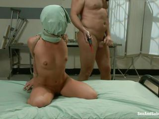 Sheena is a cute brunette, but you couldn't tell any of that here. Her arms are tied behind her back a pillowcase is covering her face. She gets punished with an electric zapper, then smacked across the tits with a galley whip. This guy is sadistic but she loves it, especially when he fucks her.