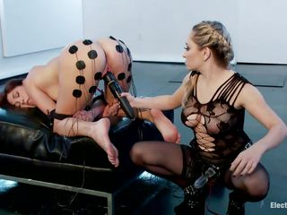 Bent over and arms bound to legs, Hanna Reilly is getting plowed from behind by Aiden with a glass strapon while Hanna works a vibrator on herself. After Hanna cums, Aiden smacks her with an electrified stick. She gets shocks from electrodes taped to her ass and legs. Hanna cums again and again!