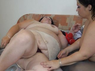 Huge whores are having some fun. These bitches are fat and old, just the way we like them. One of them grabs a double ended dildo and begins inserting it in her girlfriends vagina. Something tells us that the dildo won't be enough for these bitches, the need some harder and bigger toys, will they use some?