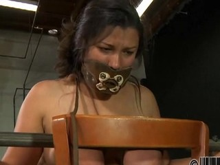 Caged beauty removes her pretty clothings in internment