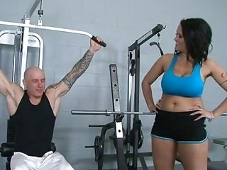 Dark haired pornstar with huge puppies gets banged in gym