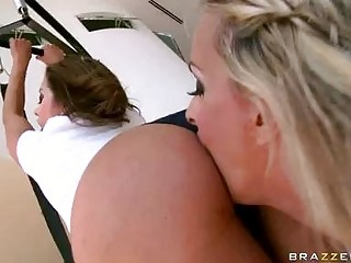 Two bootylicious pornstars with large melons licking and fingering in gym