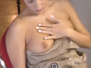 Pigtailed young lady in a diaper masturbates