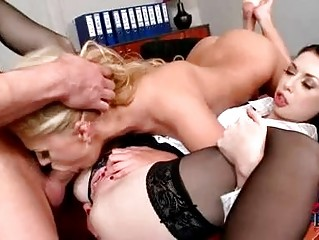 Turned on stud enjoys threesome with whorish secretaries in hig heels