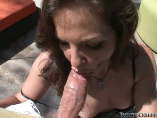 Bobbi Starr and Rocck Siffredi cock sucking outside
