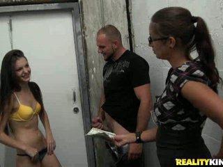 Foxy brunette sucking cock in hallway for money