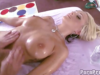 Nude busty blonde Briana Blair is oiled up from top to toe. She enjoys the massage. But her gorgeous body and big tits make guy's cock hard. Soon she finds herself getting her wet pussy pounded.