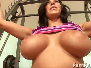 Veronica Rayne is a gorgeous brunette milf with huge spectacular tits. She loves working out and fucking at the same time. She does exercises showing off her big melons and then gets her hot pussy stuffed doggy style.