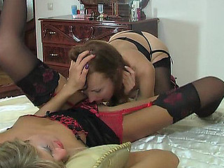 Awesome hottie in luxury nylons widening her legs for lesbo workout