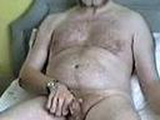 After watching my neighbour naked in her garden sunbathing, I sit on the bed masturbating and shoot a load of cum. I am not finished so I jerk my cock again and then cum again with another load of sperm. I then sit back thinking of my double orgasm as the camera zooms to my cock still dripping with cum.