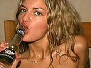 Cracking blonde is drinking beer with the horny voyeur closely watching her every move and gulp. When she's done with the drink she drives the guy crazy stuffing the empty bottle deep into her soggy beaver!