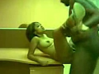 The aroused couple gets nude and finds the desk a perfect setting to fuck on. The pretty chick gets on top of it, spreads her legs and leans back as his penis reaches out to her cunt and pushed inside!