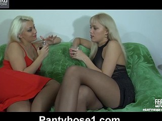 Two gorgeous honeys in suntan hose get more intimate after a scarcely any drinks