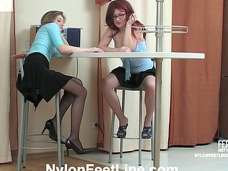 Salacious chicks playing sexy games rubbing snatches with their nyloned feet
