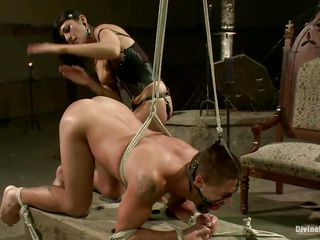 Beretta James has Dominic Pacifico right where she wants him: tied up and gagged, bent over, and helpless to stop her from having her way with him. She spanks him, then uses her big strapon to fuck his asshole. She stops to squeeze his balls and jack him off a bit, then back in his browneye it goes.