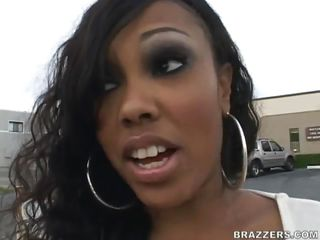 This big booty ebony slut is in the middle of the street rubbing her sexy tits. Look at that pretty face, is she going to get fucked in the mouth and cummed on it? After a short talk she gets her hot ass in a garage and this guy starts licking her big firm tits, rubbing her hairy cunt while doing that. He spanks that nice booty from behind fingering her pussy and making this slut ready for a hard cock inside her. Is she going to get hot white spunk on her ebony booty?