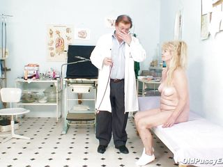 This mature female with big breasts is at the gynecologist for a pussy exam. She is completely naked sitting on the bed and the doctor starts to inspect her large hairy vagina. He gapes it and look inside very carefully. After that he introduce his finger in the women ass very deep and slow.