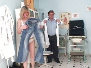 Blonde slut Agnesa is getting checked by her doctor. She is a mature bitch with big natural boobs, slutty face and hairy pussy. After he asks her to undress the medic is taking her vitals and uses suckers to make her nipples harder. This doc has a dirty mind and surely he will make her horny, who knows what tricks he has to make this old slut ready to fuck.