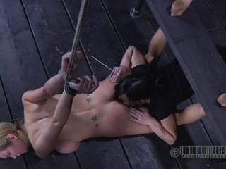 Hot blonde Rain lies on the floor with her titties pressed down and with her hands and feet tied up. Her girlfriend is laughing at her and puts a sharp stick in her cunt and nose, after licking her pussy hard. She spits in her mouth and then spreads her saliva all over her face. Wanna see some more domination?