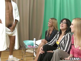 Three slutty milfs are on the couch waiting for the guy to enter. He comes in, undresses and allows the bitches to shave his cock. The milfs are carefully shaving his genital area and get really excited about it. Maybe after he will be hairless they will give him a few lustful licks on his dick