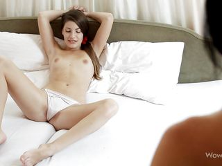 One of the young sensual chicks lays on the bed wearing only her simple white panties while the other hottie approaches her slowly. She takes her time, waits for her girl to take off those panties and then gives her pussy one hell of a lick. What a lustful slim chicks, it's a pleasure to watch them!