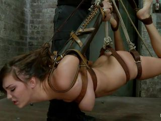 Holly is tied up and the guy hangs her so he can fuck her pretty mouth. Her sexy body is tied up and after she is suspended he grabs her by the hair and roughly fucks her as she opens that mouth wide. The slut enjoys it and the dick slides in her throat, does she deserves to swallow some semen?