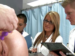 A doctor puts some lube on sexual toy then inserts it in a hot blonde woman's anus, then takes another one and inserts it in her vagina. Three other doctors are watching and writing the results of these so called tests. The doctor pulls his dick out and gets it sucked by the woman.
