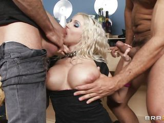 Those huge boobs are bouncing as she sucks cock and these guys are slapping them with their cocks and then continue fucking her pretty mouth. She's a horny blonde milf and nothing can stand between her and fresh hot semen. This slut want's hot jizz in her mouth and she's willing to do everything it takes for it. Watch her taking it between those boobs and in her mouth until the guys take off her panties and fuck her shaved pussy.