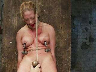 Her naked body is enough to make a man or a women horny and ready to fuck her but why not punish her for being so sexy. They've tied her and ball gag her mouth and after that, rubbed the delicious cunt between those hot thighs with a vibrator until she moaned with lust. The rope that goes right between her pussy lips and the clamps with weights on her nipples are going to make her cunt went and ready to fuck, don't you think so?